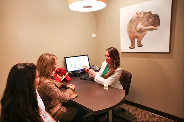 Dr. Westervelt in consultation with parent and patient